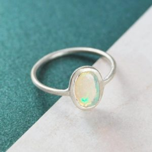 Opal Ring, Sterling Silver Ring, Birthstone Ring, Ethiopian Opal, Birthday Gifts, Welo opal, Oval Ring, October Birthstone, Silver Jewellery | Natural genuine Opal rings, simple unique handcrafted gemstone rings. #rings #jewelry #shopping #gift #handmade #fashion #style #affiliate #ad