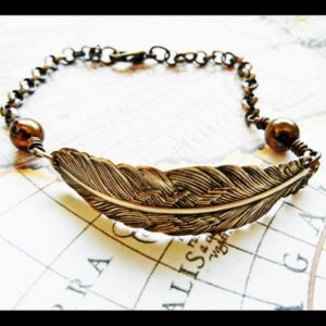 Shop Pearl Bracelets! Golden Feather and Chocolate Freshwater Pearl Bracelet | Natural genuine Pearl bracelets. Buy crystal jewelry, handmade handcrafted artisan jewelry for women.  Unique handmade gift ideas. #jewelry #beadedbracelets #beadedjewelry #gift #shopping #handmadejewelry #fashion #style #product #bracelets #affiliate #ad
