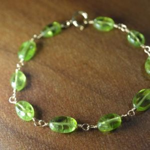 Shop Peridot Bracelets! Peridot Beaded Bracelet in Sterling Silver, 14k Gold Fill // August Birthstone // Wire Wrapped Peridot // 16th Anniversary // Oval Peridot | Natural genuine Peridot bracelets. Buy crystal jewelry, handmade handcrafted artisan jewelry for women.  Unique handmade gift ideas. #jewelry #beadedbracelets #beadedjewelry #gift #shopping #handmadejewelry #fashion #style #product #bracelets #affiliate #ad