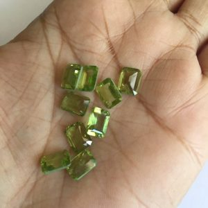 Shop Peridot Faceted Beads! 50 Pieces Wholesale 8x6mm Peridot Emerald Cut Faceted Flat Back Green Color Loose Cabochon Lot SKU-P3 | Natural genuine faceted Peridot beads for beading and jewelry making.  #jewelry #beads #beadedjewelry #diyjewelry #jewelrymaking #beadstore #beading #affiliate #ad