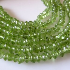 Shop Peridot Bead Shapes! 10 Strands Natural Peridot Button Beads, 5mm Peridot Beads, Wholesale Peridot Gemstones, 13.5 Inch Strand, SKU-2773/2 | Natural genuine other-shape Peridot beads for beading and jewelry making.  #jewelry #beads #beadedjewelry #diyjewelry #jewelrymaking #beadstore #beading #affiliate #ad