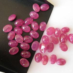 Shop Ruby Cabochons! 10 Pieces 6mm To 7mm Natural Ruby Smooth Oval Shaped Ruby Color Loose Cabochons BB333 | Natural genuine stones & crystals in various shapes & sizes. Buy raw cut, tumbled, or polished gemstones for making jewelry or crystal healing energy vibration raising reiki stones. #crystals #gemstones #crystalhealing #crystalsandgemstones #energyhealing #affiliate #ad