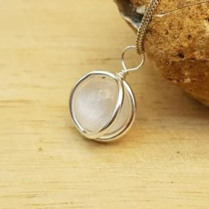 Shop Selenite Pendants! Minimalist Selenite circle Pendant necklace. Crystal Reiki jewelry uk. Sterling silver necklace. Wire wrap pendant | Natural genuine Selenite pendants. Buy crystal jewelry, handmade handcrafted artisan jewelry for women.  Unique handmade gift ideas. #jewelry #beadedpendants #beadedjewelry #gift #shopping #handmadejewelry #fashion #style #product #pendants #affiliate #ad