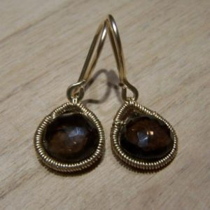 Shop Smoky Quartz Earrings! Smoky Quartz,  14K goldfilled coil wrap, hook earwire  earrings | Natural genuine Smoky Quartz earrings. Buy crystal jewelry, handmade handcrafted artisan jewelry for women.  Unique handmade gift ideas. #jewelry #beadedearrings #beadedjewelry #gift #shopping #handmadejewelry #fashion #style #product #earrings #affiliate #ad