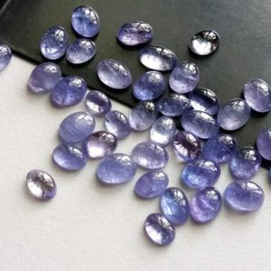 4x6mm – 5x7mm Tanzanite Plain Cabochons, Natural Tanzanite Plain Oval Flat Back Cabochons For Jewelry (5Pcs To 10Pcs Options) – PDG198 | Natural genuine stones & crystals in various shapes & sizes. Buy raw cut, tumbled, or polished gemstones for making jewelry or crystal healing energy vibration raising reiki stones. #crystals #gemstones #crystalhealing #crystalsandgemstones #energyhealing #affiliate #ad