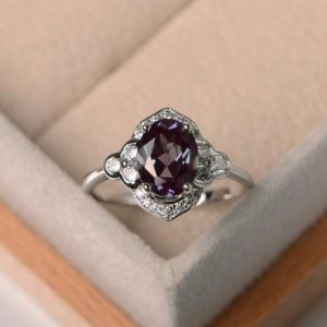 lab alexandrite ring, engagement ring, oval cut, color changing gemstone ring ,sterling silver ring, June birthstone | Natural genuine Gemstone rings, simple unique alternative gemstone engagement rings. #rings #jewelry #bridal #wedding #jewelryaccessories #engagementrings #weddingideas #affiliate #ad