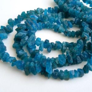 Shop Apatite Chip & Nugget Beads! 8-14mm Neon Apatite Rough Chip Beads, Natural Raw Apatite Briolette Beads, Neon Apatite Rough Gemstones (7IN To 14IN Options) – PUSDG18   Natural genuine chip Apatite beads for beading and jewelry making.  #jewelry #beads #beadedjewelry #diyjewelry #jewelrymaking #beadstore #beading #affiliate #ad