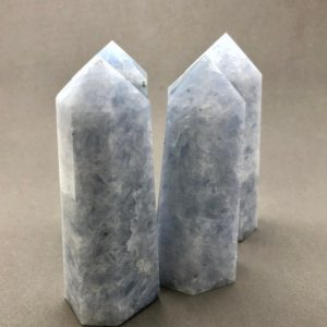 Shop Calcite Points & Wands! Blue Calcite Point | Natural genuine stones & crystals in various shapes & sizes. Buy raw cut, tumbled, or polished gemstones for making jewelry or crystal healing energy vibration raising reiki stones. #crystals #gemstones #crystalhealing #crystalsandgemstones #energyhealing #affiliate #ad