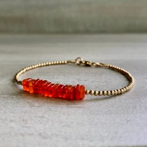 Shop Carnelian Bracelets! Carnelian Bracelet | Dainty Delicate Stone Bracelet | Sterling Silver or Gold Tiny Beads | Red Orange Square Gemstones | Natural genuine Carnelian bracelets. Buy crystal jewelry, handmade handcrafted artisan jewelry for women.  Unique handmade gift ideas. #jewelry #beadedbracelets #beadedjewelry #gift #shopping #handmadejewelry #fashion #style #product #bracelets #affiliate #ad