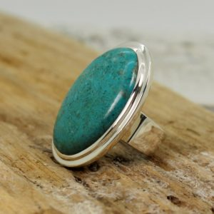 Shop Chrysocolla Rings! Huge… Chrysocolla stone ring amazing turquoise blue color oval shape natural Chrysocolla stone set on 925 sterling solid silver handmade | Natural genuine Chrysocolla rings, simple unique handcrafted gemstone rings. #rings #jewelry #shopping #gift #handmade #fashion #style #affiliate #ad