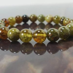 Shop Garnet Bracelets! Green Garnet Bracelet 8mm, Andradite Grossular Garnet, Natural Gemstone Bracelet, Garnet Unisex Women Men Beaded Bracelet + Gift Box | Natural genuine Garnet bracelets. Buy crystal jewelry, handmade handcrafted artisan jewelry for women.  Unique handmade gift ideas. #jewelry #beadedbracelets #beadedjewelry #gift #shopping #handmadejewelry #fashion #style #product #bracelets #affiliate #ad