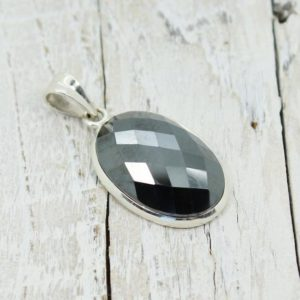 Shop Hematite Pendants! Faceted Hematite pendant oval shape stone set on 925 sterling silver unisex style great quality jewelry | Natural genuine Hematite pendants. Buy crystal jewelry, handmade handcrafted artisan jewelry for women.  Unique handmade gift ideas. #jewelry #beadedpendants #beadedjewelry #gift #shopping #handmadejewelry #fashion #style #product #pendants #affiliate #ad
