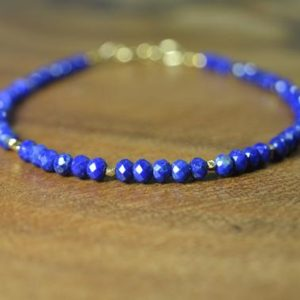 Shop Lapis Lazuli Bracelets! Dainty Lapis Lazuli Stacking Bracelet in Sterling Silver, 14k Gold Fill // Minimalist // December Birthstone // 9th Anniversary // Healing | Natural genuine Lapis Lazuli bracelets. Buy crystal jewelry, handmade handcrafted artisan jewelry for women.  Unique handmade gift ideas. #jewelry #beadedbracelets #beadedjewelry #gift #shopping #handmadejewelry #fashion #style #product #bracelets #affiliate #ad