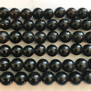 Shop Onyx Round Beads! onyx round 12mm gemstone Bead -15 inch strand 1 strand/3 strands | Natural genuine round Onyx beads for beading and jewelry making.  #jewelry #beads #beadedjewelry #diyjewelry #jewelrymaking #beadstore #beading #affiliate #ad
