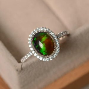Black opal ring, halo ring, sterling silver, oval opal rings, engagement rings | Natural genuine Opal rings, simple unique alternative gemstone engagement rings. #rings #jewelry #bridal #wedding #jewelryaccessories #engagementrings #weddingideas #affiliate #ad