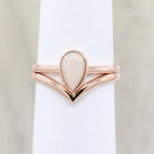 Shop Opal Rings! Chevron Opal Engagement Ring Set.Opal Wedding Ring Set.14K Solid Gold & Natural Opal. Unique Opal engagement ring set.bridal Ring Set | Natural genuine Opal rings, simple unique alternative gemstone engagement rings. #rings #jewelry #bridal #wedding #jewelryaccessories #engagementrings #weddingideas #affiliate #ad