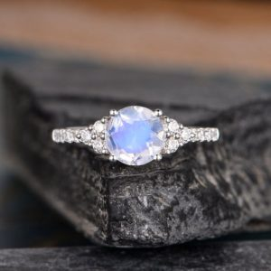 Shop Rainbow Moonstone Rings! White Gold Moonstone Engagement Ring Cluster Moissanite Half Eternity Rainbow Moonstone Ring 1CT Round Cut Women Bridal Anniversary | Natural genuine Rainbow Moonstone rings, simple unique alternative gemstone engagement rings. #rings #jewelry #bridal #wedding #jewelryaccessories #engagementrings #weddingideas #affiliate #ad