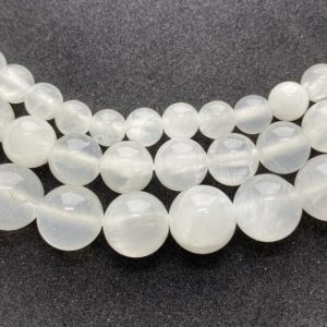 """Shop Selenite Beads! Selenite Gemstone Beads, available in 6-10mm.  15"""" strands of round, transparent White Selenite beads. 