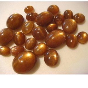 Shop Sunstone Cabochons! 20 Pieces 13mm To 9mm Natural Sunstone Smooth Oval Shaped Golden Brown Color Loose Cabochons SKU-GFJ | Natural genuine stones & crystals in various shapes & sizes. Buy raw cut, tumbled, or polished gemstones for making jewelry or crystal healing energy vibration raising reiki stones. #crystals #gemstones #crystalhealing #crystalsandgemstones #energyhealing #affiliate #ad