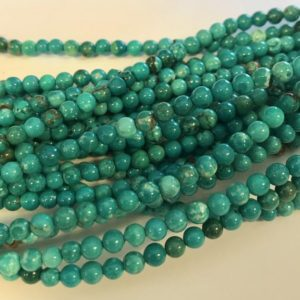 Shop Turquoise Round Beads! turquoise 4mm round Natural Gemstone Bead -15.5 inch strand–1 strand/3 strands | Natural genuine round Turquoise beads for beading and jewelry making.  #jewelry #beads #beadedjewelry #diyjewelry #jewelrymaking #beadstore #beading #affiliate #ad