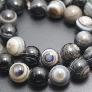 Shop Agate Beads! 6mm / 8mm / 10mm / 12mm Black Eyes Agate Smooth And Round Beads, 15 Inches One Starand | Natural genuine beads Agate beads for beading and jewelry making.  #jewelry #beads #beadedjewelry #diyjewelry #jewelrymaking #beadstore #beading #affiliate #ad