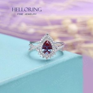 Shop Alexandrite Rings! Vintage Alexandrite Engagement ring set White gold Women, unique Pear shaped wedding ring Halo diamond/moissanite,Anniversary Gifts for her | Natural genuine Alexandrite rings, simple unique alternative gemstone engagement rings. #rings #jewelry #bridal #wedding #jewelryaccessories #engagementrings #weddingideas #affiliate #ad