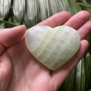 Shop Calcite Shapes! Pistachio Calcite Heart, Green Pistachio Calcite Heart, Pistachio Calcite Crystal, Puffy Pistachio Calcite Hearts | Natural genuine stones & crystals in various shapes & sizes. Buy raw cut, tumbled, or polished gemstones for making jewelry or crystal healing energy vibration raising reiki stones. #crystals #gemstones #crystalhealing #crystalsandgemstones #energyhealing #affiliate #ad