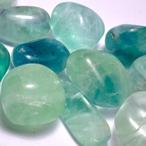 Shop Fluorite Stones & Crystals! Green Fluorite Tumbled Stones | Natural genuine stones & crystals in various shapes & sizes. Buy raw cut, tumbled, or polished gemstones for making jewelry or crystal healing energy vibration raising reiki stones. #crystals #gemstones #crystalhealing #crystalsandgemstones #energyhealing #affiliate #ad