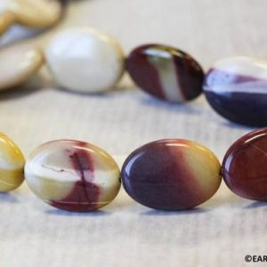 """Shop Mookaite Beads! L/ Mookaite 18x25mm/ 15x20mm Flat Oval beads 16"""" strand Natural mixed red and yellow beads Origin Australia 
