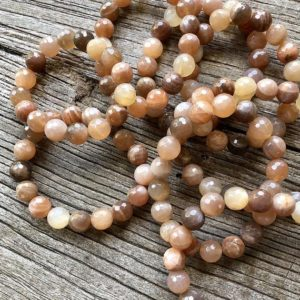 Shop Moonstone Bracelets! Peach Moonstone Grounding Bracelet WS2548 | Natural genuine Moonstone bracelets. Buy crystal jewelry, handmade handcrafted artisan jewelry for women.  Unique handmade gift ideas. #jewelry #beadedbracelets #beadedjewelry #gift #shopping #handmadejewelry #fashion #style #product #bracelets #affiliate #ad