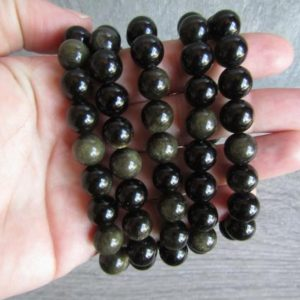 Shop Obsidian Bracelets! Obsidian 10 Mm Round Bracelet Stretchy String G93 | Natural genuine Obsidian bracelets. Buy crystal jewelry, handmade handcrafted artisan jewelry for women.  Unique handmade gift ideas. #jewelry #beadedbracelets #beadedjewelry #gift #shopping #handmadejewelry #fashion #style #product #bracelets #affiliate #ad