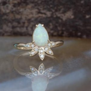 Shop Opal Rings! Genuine opal ring-Pear opal engagement ring-Gatsby ring-Opal ring vintage-Promise ring-Vintage Art Deco Style Ring-White fire opal ring | Natural genuine Opal rings, simple unique alternative gemstone engagement rings. #rings #jewelry #bridal #wedding #jewelryaccessories #engagementrings #weddingideas #affiliate #ad
