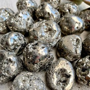 Shop Tumbled Pyrite Crystals & Pocket Stones! Pyrite Tumbled Stone From Peru | Natural genuine stones & crystals in various shapes & sizes. Buy raw cut, tumbled, or polished gemstones for making jewelry or crystal healing energy vibration raising reiki stones. #crystals #gemstones #crystalhealing #crystalsandgemstones #energyhealing #affiliate #ad