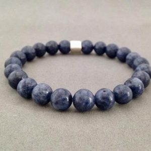 Shop Sapphire Bracelets! 8MM Blue Sapphire Stretch Bead Bracelet with Karen Hill Silver Accent Bead | Natural genuine Sapphire bracelets. Buy crystal jewelry, handmade handcrafted artisan jewelry for women.  Unique handmade gift ideas. #jewelry #beadedbracelets #beadedjewelry #gift #shopping #handmadejewelry #fashion #style #product #bracelets #affiliate #ad