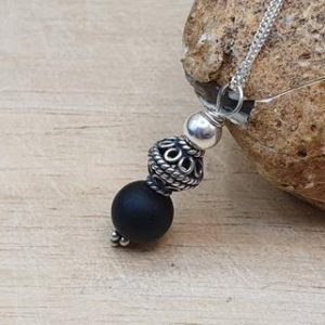 Shop Shungite Pendants! Rare black Shungite pendant necklace. Bali silver. 5% carbon from Kazakhstan. Reiki jewelry uk. Small Wire wrapped pendant. 10mm stone | Natural genuine Shungite pendants. Buy crystal jewelry, handmade handcrafted artisan jewelry for women.  Unique handmade gift ideas. #jewelry #beadedpendants #beadedjewelry #gift #shopping #handmadejewelry #fashion #style #product #pendants #affiliate #ad