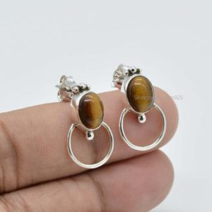 Shop Tiger Eye Earrings! Natural Tiger Eye Stud Earrings | Dangle Earrings | 7x9mm Oval Tiger Eye Earrings | Silver Earrings | Yellow Stone Earring | Women Earrings | Natural genuine Tiger Eye earrings. Buy crystal jewelry, handmade handcrafted artisan jewelry for women.  Unique handmade gift ideas. #jewelry #beadedearrings #beadedjewelry #gift #shopping #handmadejewelry #fashion #style #product #earrings #affiliate #ad