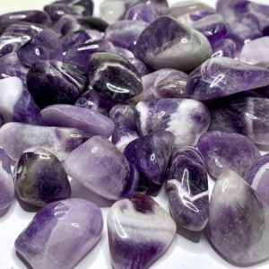 Shop Tumbled Amethyst Crystals & Pocket Stones! Chevron Amethyst Tumbled Stones | Natural genuine stones & crystals in various shapes & sizes. Buy raw cut, tumbled, or polished gemstones for making jewelry or crystal healing energy vibration raising reiki stones. #crystals #gemstones #crystalhealing #crystalsandgemstones #energyhealing #affiliate #ad