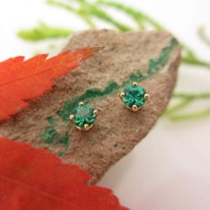 Shop Emerald Earrings! Emerald Earrings in 14k Yellow Gold | Dainty Green Stud Earrings with Lab Grown Emeralds, 3mm | Made in Oregon | Natural genuine Emerald earrings. Buy crystal jewelry, handmade handcrafted artisan jewelry for women.  Unique handmade gift ideas. #jewelry #beadedearrings #beadedjewelry #gift #shopping #handmadejewelry #fashion #style #product #earrings #affiliate #ad