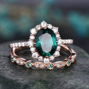 7x9mm oval green emerald engagement ring set rose gold moissanite halo May birthstone 2pcs natural emerald diamond wedding bridal ring set | Natural genuine Array rings, simple unique alternative gemstone engagement rings. #rings #jewelry #bridal #wedding #jewelryaccessories #engagementrings #weddingideas #affiliate #ad