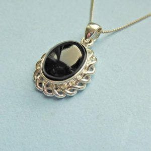 Shop Jet Pendants! Whitby Jet And Sterling Silver Scroll Edged Pendant   Natural genuine Jet pendants. Buy crystal jewelry, handmade handcrafted artisan jewelry for women.  Unique handmade gift ideas. #jewelry #beadedpendants #beadedjewelry #gift #shopping #handmadejewelry #fashion #style #product #pendants #affiliate #ad