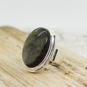 Shop Obsidian Rings! Amazing……big Obsidian golden sheen stone ring made of the most beautiful golden sheen Obsidian stone set on solid sterling silver | Natural genuine Obsidian rings, simple unique handcrafted gemstone rings. #rings #jewelry #shopping #gift #handmade #fashion #style #affiliate #ad