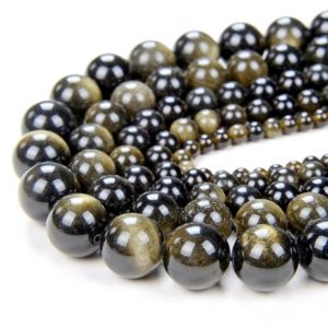 Shop Obsidian Beads! 12mm Chatoyant Golden Sheen Obsidian Gemstone Grade AA Round 12mm Loose Beads 15.5 inch Full Strand (80000343-280) | Natural genuine beads Obsidian beads for beading and jewelry making.  #jewelry #beads #beadedjewelry #diyjewelry #jewelrymaking #beadstore #beading #affiliate #ad