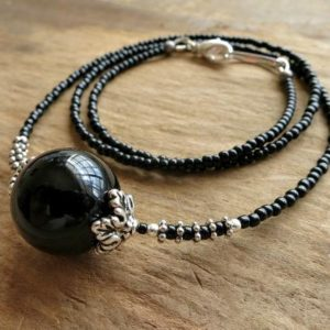 Shop Onyx Necklaces! Black & Silver Necklace, onyx sphere beaded necklace with silver accents, elegant Bohemian stone crystal ball jewelry | Natural genuine Onyx necklaces. Buy crystal jewelry, handmade handcrafted artisan jewelry for women.  Unique handmade gift ideas. #jewelry #beadednecklaces #beadedjewelry #gift #shopping #handmadejewelry #fashion #style #product #necklaces #affiliate #ad
