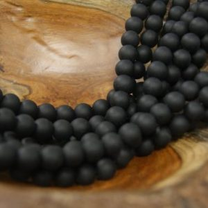 Shop Onyx Round Beads! Black Matt Onyx  4mm 6mm 8mm 10mm 12mm Smooth Round Gemstone Beads -15 inch | Natural genuine round Onyx beads for beading and jewelry making.  #jewelry #beads #beadedjewelry #diyjewelry #jewelrymaking #beadstore #beading #affiliate #ad