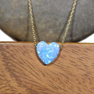 Shop Opal Pendants! Blue heart necklace, opal heart necklace, love necklace, rainbow heart pendant, love heart necklace, bff gift idea, gold heart necklace | Natural genuine Opal pendants. Buy crystal jewelry, handmade handcrafted artisan jewelry for women.  Unique handmade gift ideas. #jewelry #beadedpendants #beadedjewelry #gift #shopping #handmadejewelry #fashion #style #product #pendants #affiliate #ad