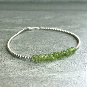 Shop Peridot Bracelets! Dainty Peridot Bracelet | Healing Crystal Jewelry | 6 7 8 9 Inch Size Bracelet | Tiny Gold or Silver Ball Bracelet | Natural genuine Peridot bracelets. Buy crystal jewelry, handmade handcrafted artisan jewelry for women.  Unique handmade gift ideas. #jewelry #beadedbracelets #beadedjewelry #gift #shopping #handmadejewelry #fashion #style #product #bracelets #affiliate #ad