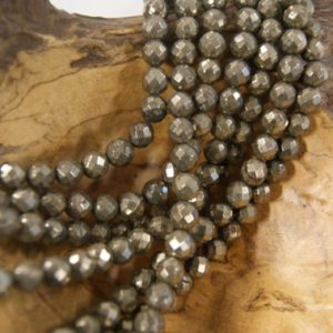 Shop Pyrite Faceted Beads! Pyrite Faceted Round Shaped Natural Gemstone Bead-8mm~ -15.5 inch strand- | Natural genuine faceted Pyrite beads for beading and jewelry making.  #jewelry #beads #beadedjewelry #diyjewelry #jewelrymaking #beadstore #beading #affiliate #ad