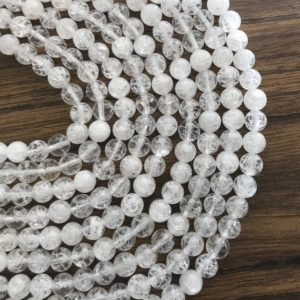 Shop Quartz Crystal Round Beads! Natural Cracked Quartz 6mm 8mm Round Smooth Natural Gemstone Bead–15.5 inch strand- | Natural genuine round Quartz beads for beading and jewelry making.  #jewelry #beads #beadedjewelry #diyjewelry #jewelrymaking #beadstore #beading #affiliate #ad