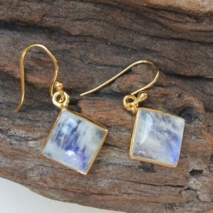 Shop Rainbow Moonstone Earrings! Gold Moonstone earrings, Square Moonstone earrings, Gold plated gem earrings, Rainbow Moonstone jewelry, Luxury earrings, Shiny white & gold | Natural genuine Rainbow Moonstone earrings. Buy crystal jewelry, handmade handcrafted artisan jewelry for women.  Unique handmade gift ideas. #jewelry #beadedearrings #beadedjewelry #gift #shopping #handmadejewelry #fashion #style #product #earrings #affiliate #ad