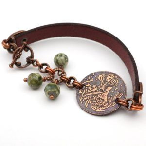 Shop Rainforest Jasper Jewelry! Copper mermaid bracelet, siren jewelry, metal etching, green rhyolite beads, 7 3/4 inches long, fits 6 3/4 inch wrist | Natural genuine Rainforest Jasper jewelry. Buy crystal jewelry, handmade handcrafted artisan jewelry for women.  Unique handmade gift ideas. #jewelry #beadedjewelry #beadedjewelry #gift #shopping #handmadejewelry #fashion #style #product #jewelry #affiliate #ad